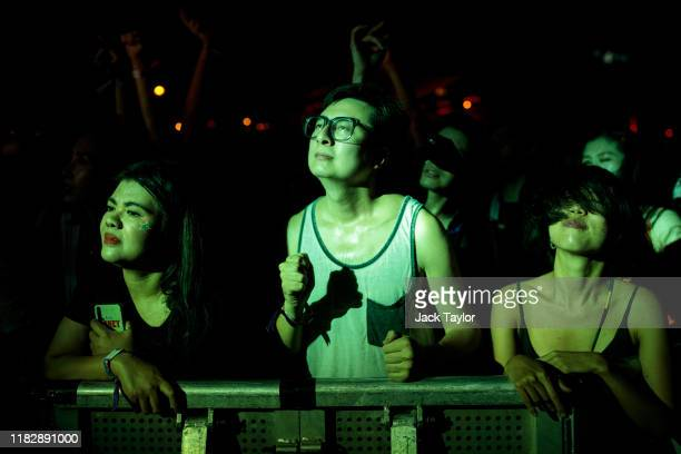 Festivalgoers react to a performance by Australian rock band King Gizzard the Lizard Wizard on day one of the Maho Rasop Festival 2019 on November 16...