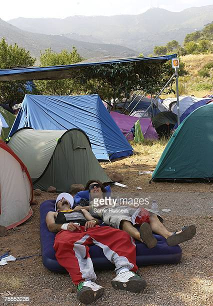Festivalgoers relax at the International Festival of Benicassim on July 19 2007 in Benicassim Spain The festival attracts people from all over Europe...
