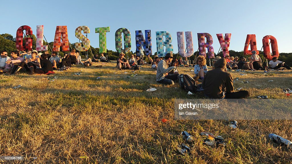 Festival-goers relax in a field at sunset during Day 1 of the Glastonbury Festival on June 24, 2010 in Glastonbury, England. This year sees the 40th anniversary of the festival which was started by a dairy farmer, Michael Evis in 1970 and has grown into the largest music festival in Europe.