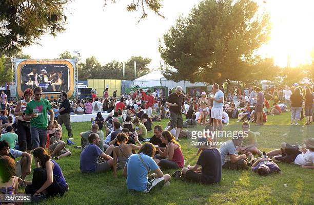 Festivalgoers relax in the evening sunshine at International Festival of Benicassim on July 20 2007 in Benicassim Spain The festival attracts people...
