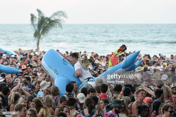 Festivalgoers ride inflatable whales over the crowd while MGMT performs at the Hangout Stage during 2017 Hangout Music Festival on May 19 2017 in...