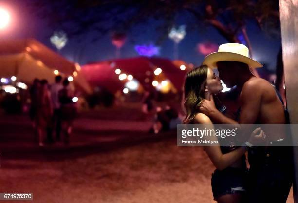 Festivalgoers share a moment during day 2 of 2017 Stagecoach California's Country Music Festival at the Empire Polo Club on April 29 2017 in Indio...