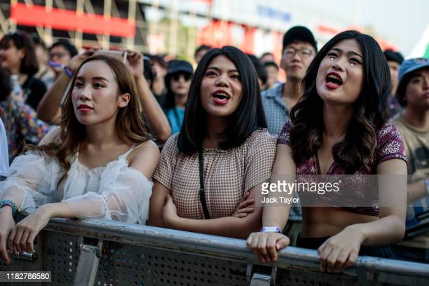 Festivalgoers sing along during a performance on day one of the Maho Rasop Festival 2019 on November 16 2019 in Bangkok Thailand