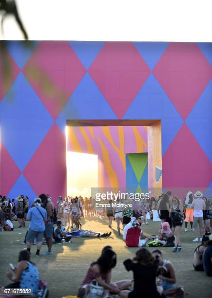 Festivalgoers sit in the shade of 'is this what brings things into focus' art installation by Joanne Tathan and Tom O'Sullivan is seen during day 2...