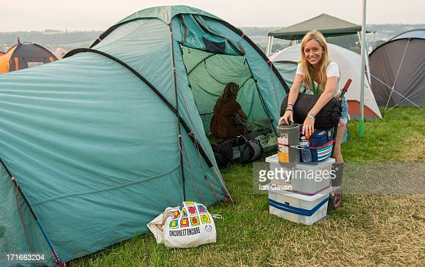 Festivalgoers stock their tent with supplies prior to the 2013 Glastonbury Festival at Worthy Farm on June 26 2013 in Glastonbury England