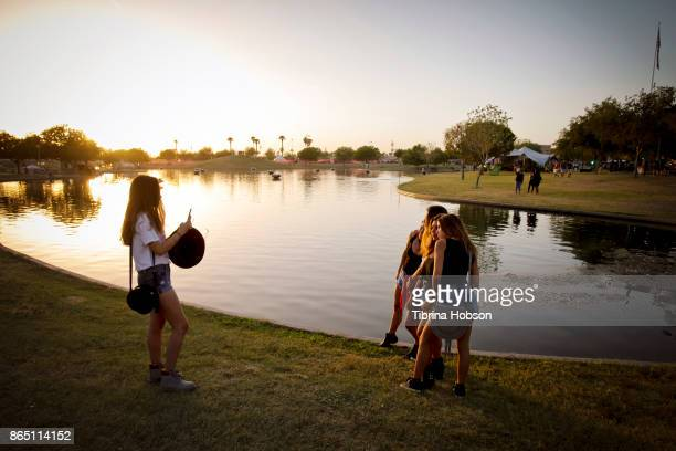 Festivalgoers take a photo at the Lost Lake Music Festival on October 21 2017 in Phoenix Arizona