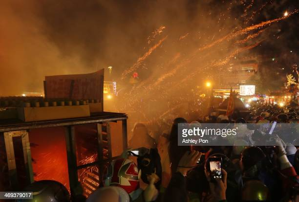 Festival-goers take part in the annual Yanshuei Beehive Rockets Fireworks Festival on February 14, 2014 in Tainan, Taiwan. The festival, 15 days...