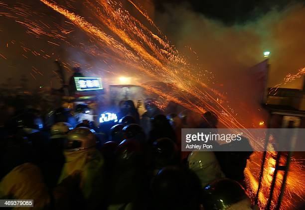 Festivalgoers take part in the annual Yanshuei Beehive Rockets Fireworks Festival on February 14 2014 in Tainan Taiwan The festival 15 days after the...