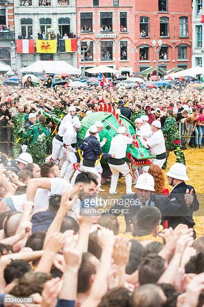 Festivalgoers take part in the Ducasse de Mons or Doudou folklore festival on May 22 2016 in Mons The Doudou feast compromises two parts a procession...