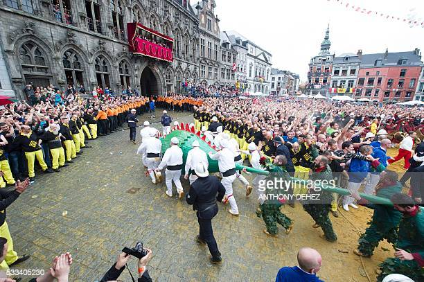 Festivalgoers take part in the Ducasse de Mons or Doudou folkloric festival in Mons on May 22 2016 The Doudou feast compromises two parts a...