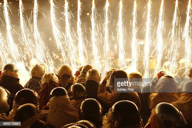 Festival-goers take part in the waterfall fireworks during the annual Yanshuei Beehive Rockets Fireworks Festival on February 14, 2014 in Tainan,...