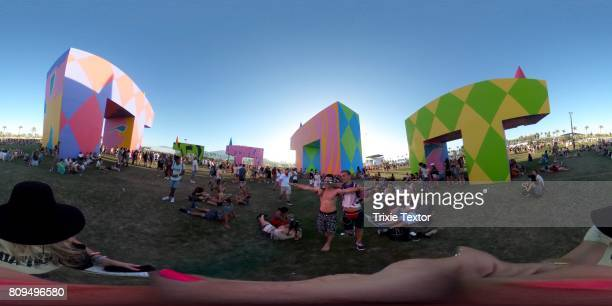 Festivalgoers walk amongst the art installation 'Is this what brings things into focus' during day 1 of the Coachella Valley Music And Arts Festival...