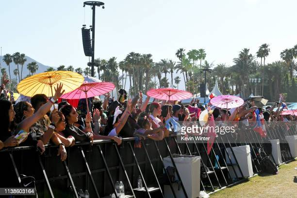 Festivalgoers watch Bad Bunny perform at Coachella Stage during the 2019 Coachella Valley Music And Arts Festival on April 21, 2019 in Indio,...