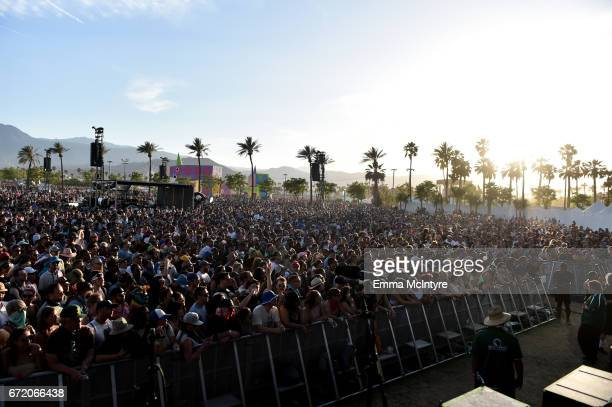 Festivalgoers watch Future Islands perform at the Outdoor Theatre during day 3 of the Coachella Valley Music And Arts Festival at the Empire Polo...