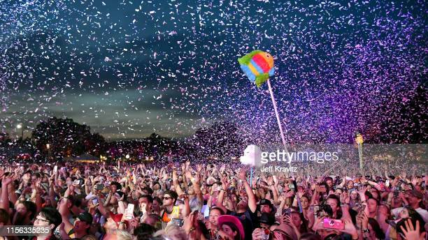 Festivalgoers watch Kacey Musgraves perform on Which Stage during the 2019 Bonnaroo Arts And Music Festival on June 15, 2019 in Manchester, Tennessee.