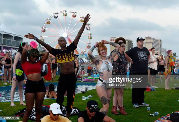 Festivalgoers watch MGMT perform at the Hangout Stage during 2017 Hangout Music Festival on May 19 2017 in Gulf Shores Alabama
