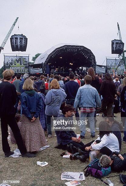 Festival-goers watching a performance on the NME stage at the Glastonbury Festival, near Pilton, Somerset, circa 1995.