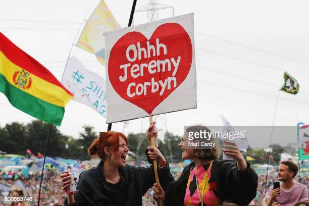 Festivalgoers with a flag supporting Labour party leader Jeremy Corbyn seen as he makes a guest appearance at the Glastonbury Festival Site on June...