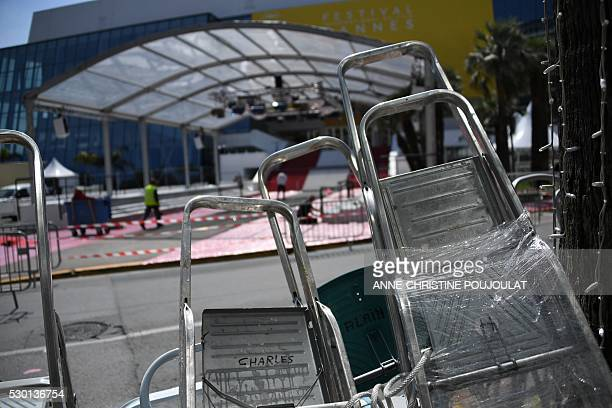 Festivalgoers'stepladders are pictured opposite the Festival's Palace in the southeastern French city of Cannes on May 10 2016 on the eve of the...