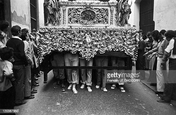 Festivals and Pilgrimages in Spain Porters carrying the palanquin during the Macarena procession during Holy Week in Seville