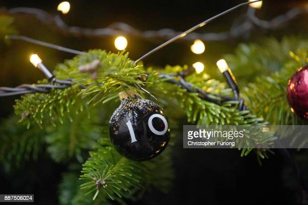 Festive bauble with the number 10 adorns the Christmas tree outside Number 10, Downing Street on December 7, 2017 in London, England. Ms May was...