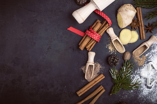 Festive border of traditional Christmas spices and cookies ingredients over rustic background with copyspace, top view - gettyimageskorea