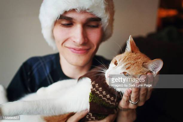 festive boy and cat - ginger lynn stock pictures, royalty-free photos & images