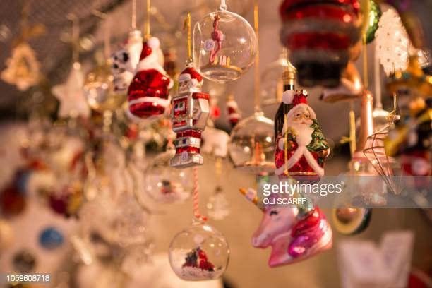 Festive Christmas decorations are displayed for sale on a stall in Manchester Christmas Market which is spread across the city centre in Manchester,...