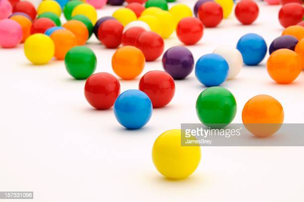 Festive, Colorful Gum Balls Candy Rolling, White Background Surface