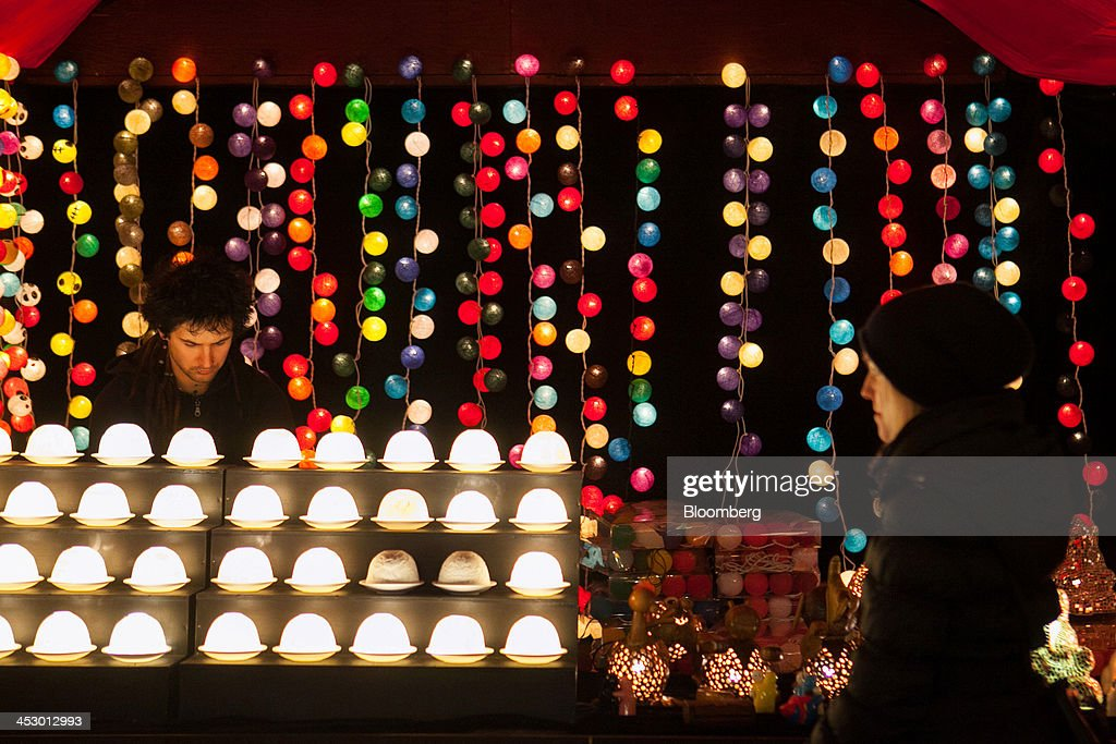 Festive decorations hang illuminated on stall at a market ahead of Christmas in Berlin, Germany, on Sunday, Dec. 1, 2013. Euro-area economic growth slowed to 0.1 percent in the third quarter after a 0.3 percent gain in the previous three months. Photographer: Krisztian Bocsi/Bloomberg via Getty Images
