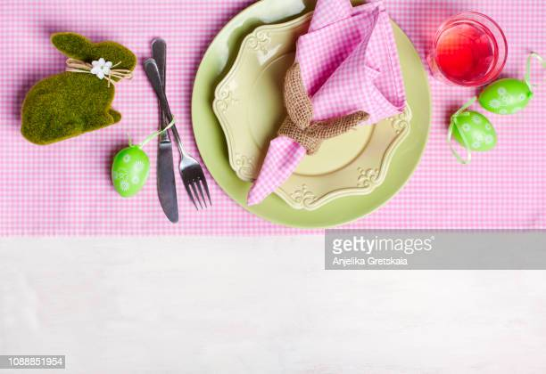 festive easter table setting with napkin easter bunny - easter dinner stock pictures, royalty-free photos & images