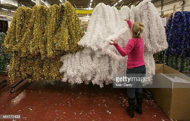 Festive employee gathers freshly made tinsel for packing for distribution in the factory area of the Festive Productions Ltd premises on December 10...