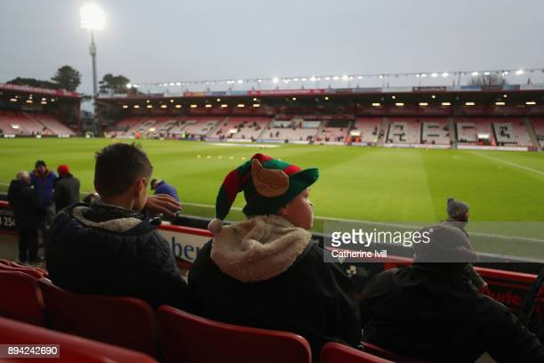 A festive fan looks on at a general view inside the stadium prior to the Premier League match between AFC Bournemouth and Liverpool at Vitality...