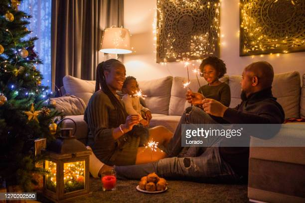 festive fun for a beautiful black family at christmas - december stock pictures, royalty-free photos & images