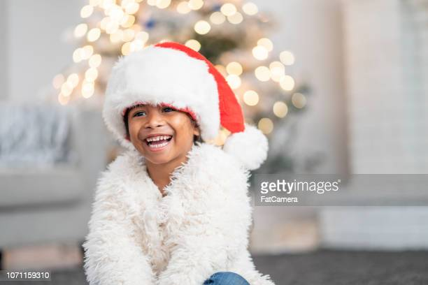 festive girl - santa hat stock pictures, royalty-free photos & images