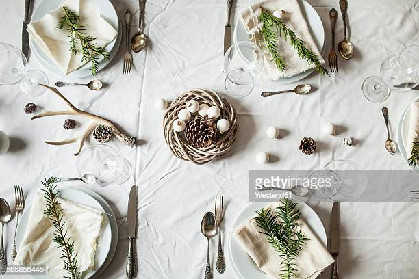festive laid table at christmas time - christmas still life stock pictures, royalty-free photos & images
