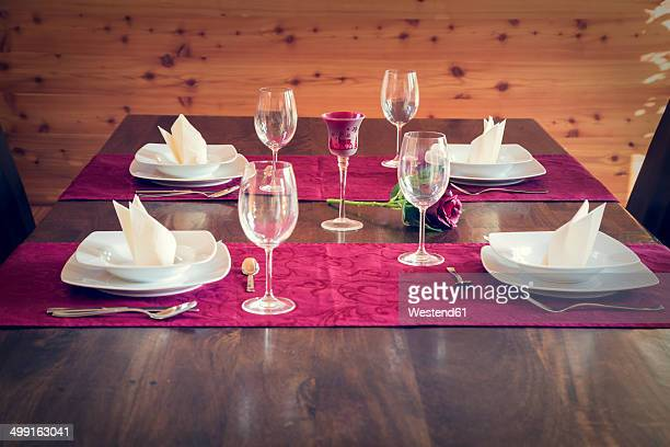 Festive laid table for four persons