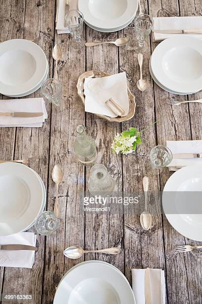Festive laid table for six persons, partial view