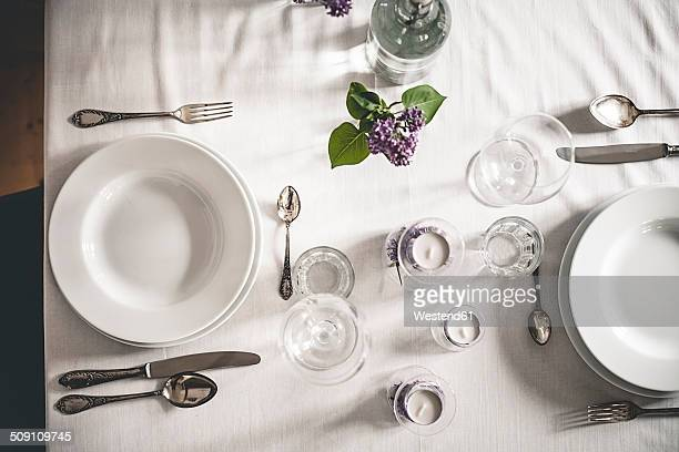 Festive laid table with lilac, Syringa, view from above