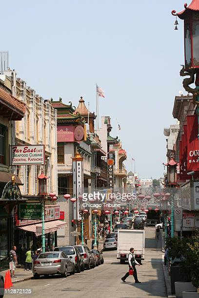 Festive lanterns line the streets of San Francisco's famously huge Chinatown home to bird and fish markets excellent restaurants and the Golden Gate...