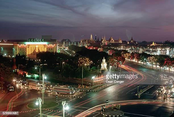 Festive lights decorate Bangkok after dark on the birthday of King Rama IX Rama who was born in 1927 in Cambridge Massachusetts was coronated in 1950...