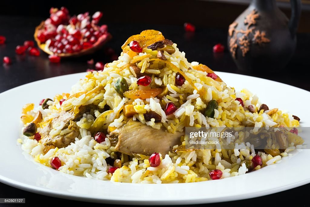 Festive middle eastern rice dish with chicken, orange peel and pistachios : Stock Photo