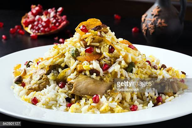 festive middle eastern rice dish with chicken, orange peel and pistachios - persian stock photos and pictures