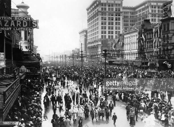 Festive occasion on Canal Street, New Orleans, Louisiana, circa 1900.