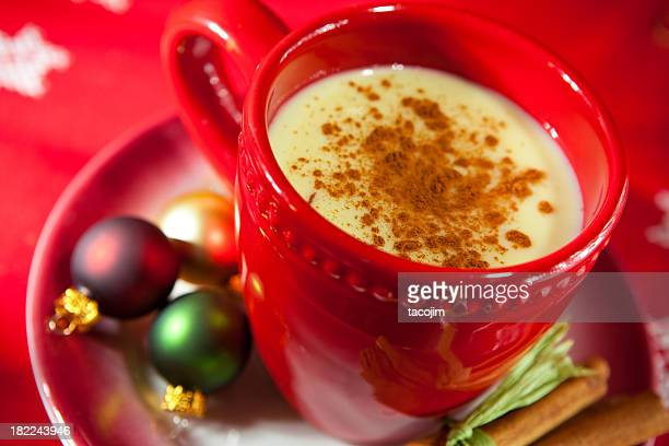 festive red cup & saucer of egg nog with christmas baubles  - eggnog stock photos and pictures