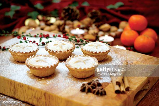 Festive scene with mince pies alongside tangerines nuts and cinnamon sticks taken on October 19 2012