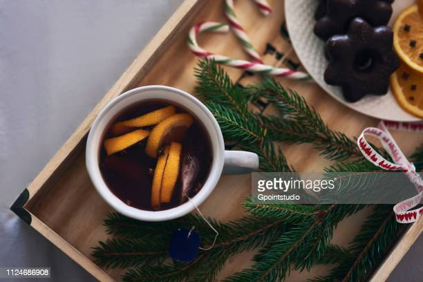 Festive tray of warm drink, Christmas biscuits and Yew tree branch