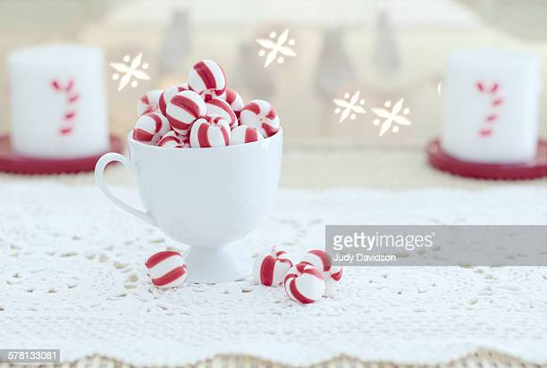 festive white cup of christmas candy - judy winter stock-fotos und bilder