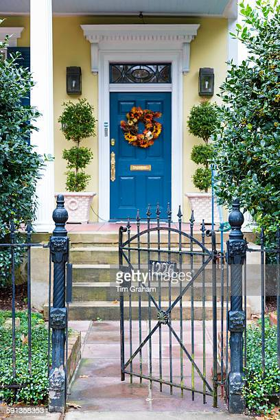 Festive wreath on traditional grand mansion house in the Garden District of New Orleans Louisiana USA