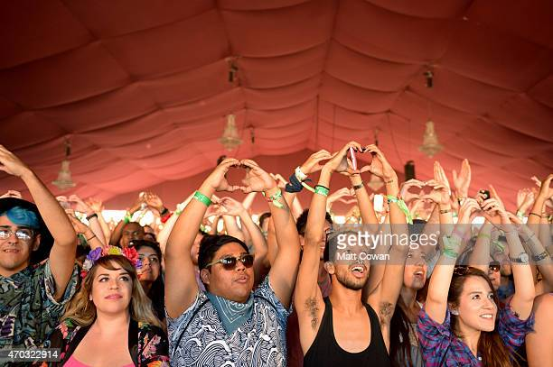 Festiver goers interact with the band Yelle as they perform onstage during day 2 of the 2015 Coachella Valley Music And Arts Festival at The Empire...